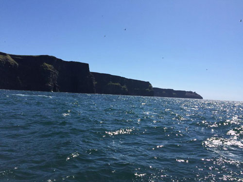cliffs of moher view from a boat tour